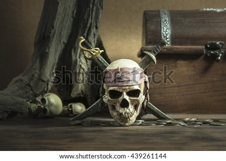 pirate skull with two swords and coffer over two head of human background still life style - stock photo