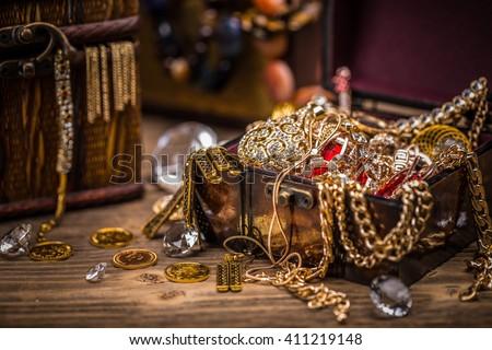 Pirate treasure chest full of jewellery - stock photo