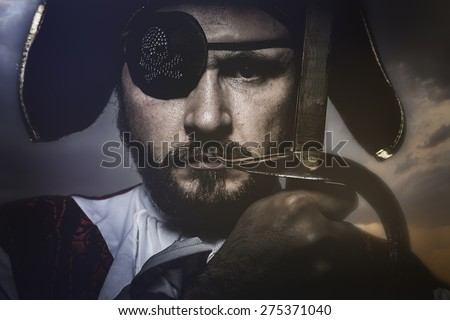 pirate with hat and eye patch holding a sword - stock photo