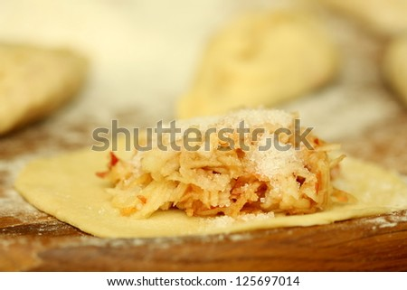 Pirogi with apples - stock photo