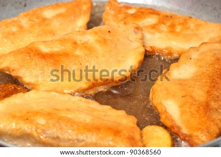 Pirojki fried. traditional Russian patty with potato.