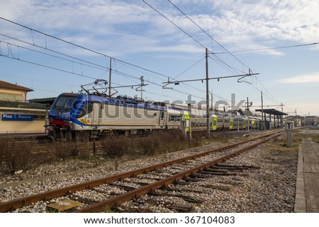 PISA-ITALY: JANUARY, 24 2016:  Trenitalia Regional Passenger Train With Electrical Locomotive E464 is departing from a Station.