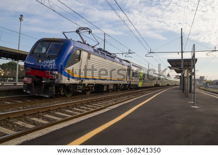 PISA, ITALY - JANUARY 24, 2016: Trenitalia Regional Passenger Train With Electrical Locomotive E464 is departing from a Station.