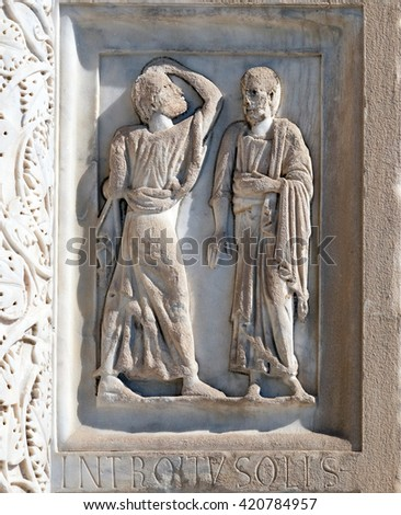 PISA, ITALY - JUNE 06, 2015: Baptistery decoration architrave arches, Cathedral in Pisa, Italy. Unesco World Heritage Site, on June 06, 2015