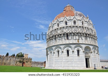 PISA, ITALY - JUNE 16 2016: Baptistery is a Romanesque style round building and the largest baptistery in Italy.