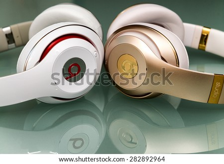 PISA, ITALY - MAY 26, 2015: Beats studio wireless an wired headset. Beats by Dr. Dre has been acquired by Apple. - stock photo