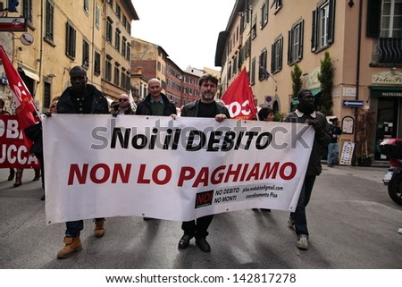 PISA, ITALY - NOVEMBER 14:Protesters march during a demonstration against austerity organized in all Europe as a European general strike on November 14, 2012 in Pisa, Italy - stock photo