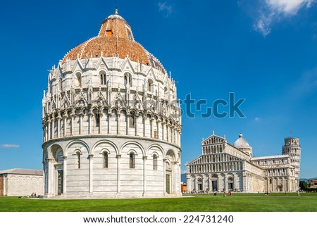 PISA,ITALY - SEPTEMBER 14,2014 - Baptistery at place Duomo in Pisa. Pisa is known worldwide for its leaning tower ,contains more than 20 other historic churches and bridges across the river Arno. - stock photo