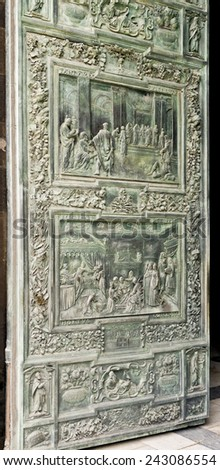 PISA, ITALY  SEPTEMBER 3, 2014: Detail of the central door of the Cathedral of Pisa depicting scenes from the life of the Virgin. - stock photo
