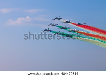 PISA, ITALY - SEPTEMBER 11, 2016: Italian Frecce Tricolori in the sky with a perfect formation during a exhibition.