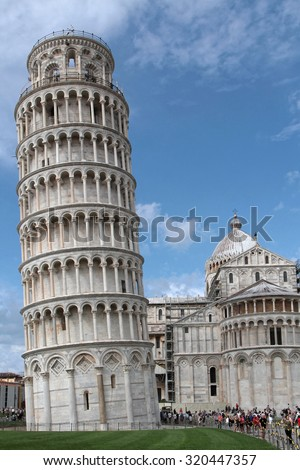 PISA, ITALY, September 15, 2015 : Pisa is known worldwide for its leaning tower (bell tower of the cathedral), the third oldest structure in Piazza del Duomo after the Cathedral and the Baptistery.