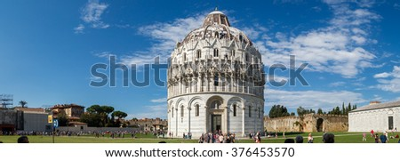 PISA, ITALY - SEPTEMBER 21, 2015 : View of Baptisery building in Cathedral Square in Pisa, Italy, on cloudy blue sky background.