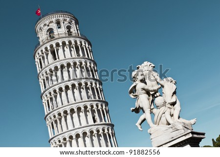 Pisa leaning tower and statue of angels