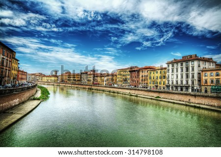 Pisa lungarno under a dramatic sky, Italy - stock photo