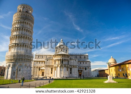 Pisa, Piazza dei miracoli, with the Basilica and the leaning tower. Shot with polarizer filter. - stock photo