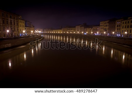 Pisa, River Arno at night in tuscany, Italy