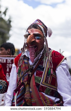 PISAC, PERU - JULY 16, 2013: masked dancers at Virgen del Carmen parade