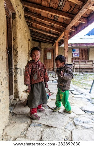 PISANG, NEPAL - NOV 4: Unidentified Tibetan children in a local school on the famous Annapurna trail on November 4, 2008, in Pisang village Nepal. The majority of the local population are Tibetans.
