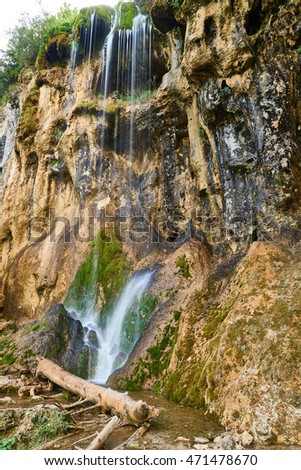 Pisoaia waterfall in romania. vertical format