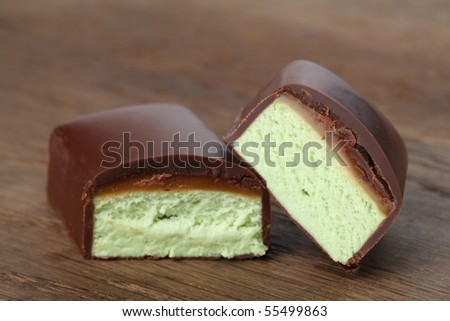 Pistachio bar with caramel and chocolate - stock photo