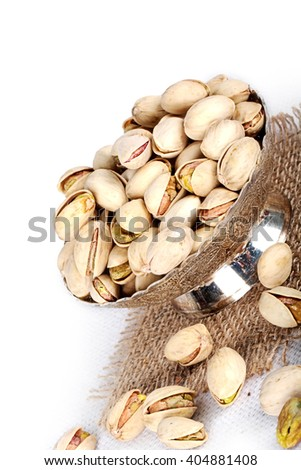 pistachio in bowl, pistachio on jute, jute - stock photo