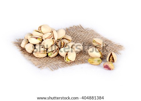 pistachio in bowl, pistachio on jute, jute, pistachio on sackcloth - stock photo