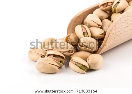 pistachio nut in scoop close up on white background isolated