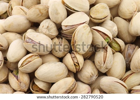 Pistachio nuts background - stock photo