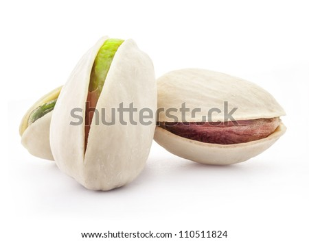 Pistachio nuts, fruits isolated on white background - stock photo