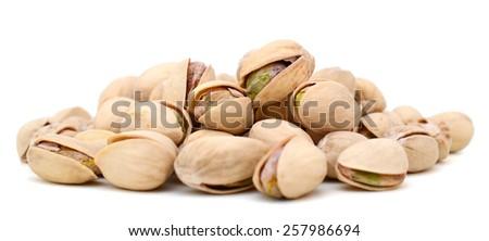 pistachio nuts isolated on white - stock photo