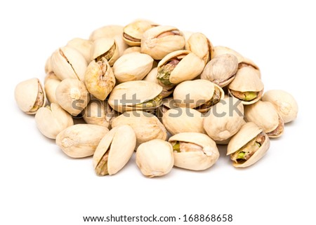 Pistachio Nuts Pile On White Background - stock photo