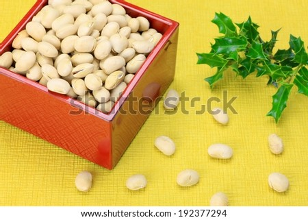 Pistachio nuts piled high in a red square box. - stock photo
