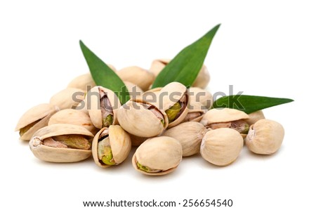 pistachio nuts with leaves on white background  - stock photo