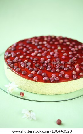 Pistachio Strawberry Mousse Cake on a green background. - stock photo