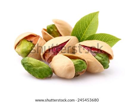 Pistachio with leaf - stock photo
