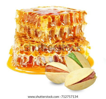 pistachios and honeycomb isolated on white