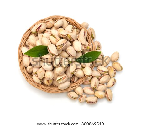 pistachios close up in basket . Isolated on a white background. - stock photo
