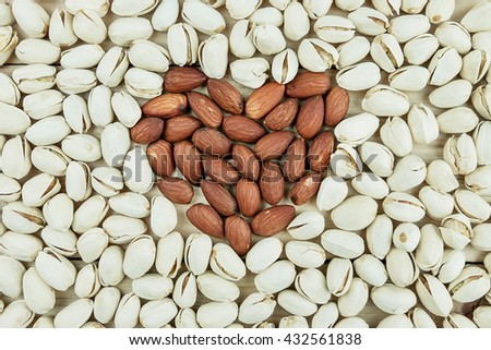 Pistachios nut on wooden table or floor background - stock photo