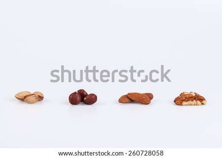Pistachios,  pecan, almonds, walnut nuts on white background - stock photo