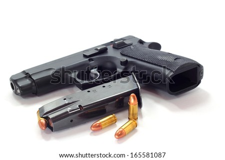 Pistol and  bullets  on white background