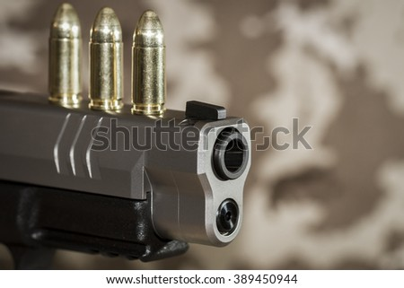 Pistol and cartridges- small depth of field - stock photo