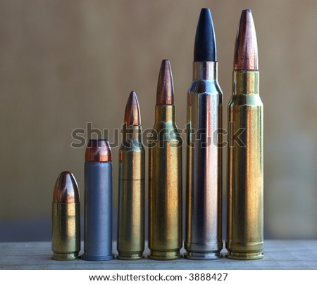pistol and rifle bullets increasing in size - stock photo