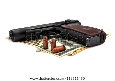 pistol, cartridges and dollars on a white background
