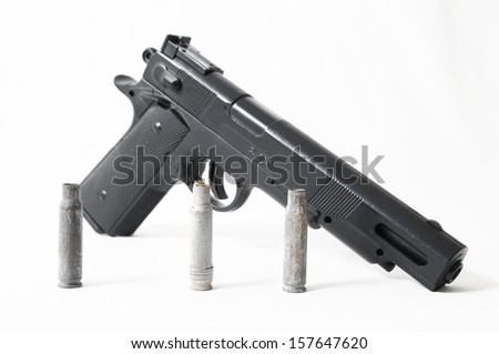 Pistol Gun and Bullets on a White Background