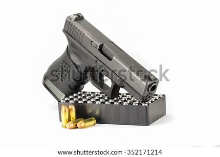 Pistol hand gun isolated on white background Stack Image - stock photo