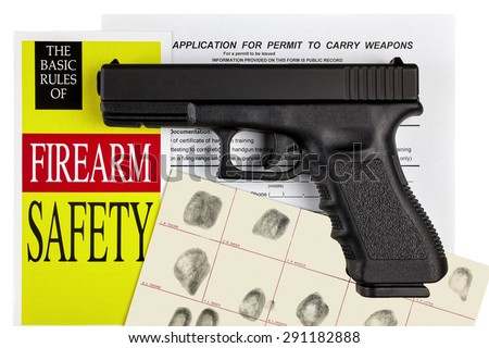 Pistol Handgun with Firearm Application and CCW Permit Fingerprint ID - stock photo