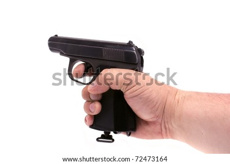Pistol in a hand - stock photo