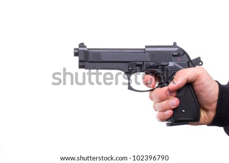 Pistol in hand, isolated on white background - stock photo