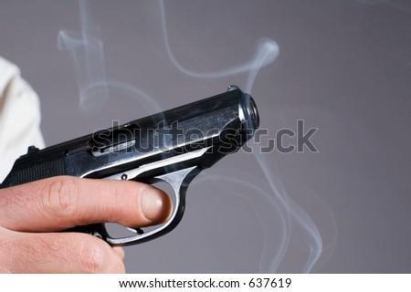 Pistol making shots - stock photo