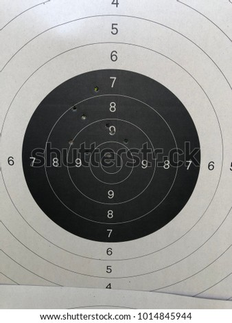 Pistol target with .22 bullet